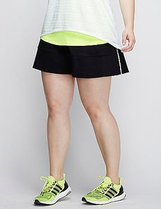 This LIVI Active skort looks like a skirt, but the attached short keeps you on the move. Even better, the two pockets, a patch pocket on the short and a mesh pocket in the wide waistband add some extra tote-along space. TruDry Wicking technology delivers supportive stretch and fade-resistant, moisture-wicking and quick-drying TruDry nylon/spandex fabric. Reflective side stripes for visibility.  lanebryant.com