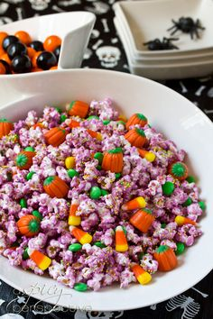 Halloween Popcorn Mix ~ Candy coated party popcorn mixed with favorite Halloween candies... Wrapped in cellophane bags, this popcorn mix also makes great edible gifts.