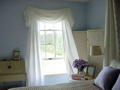 Okay, this idea is downright brilliant—that valance is actually just a round tablecloth! Awesome, right?