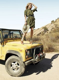 Beautiful woman on the Land Rover hood - App for Land Rovers is now available in App Store