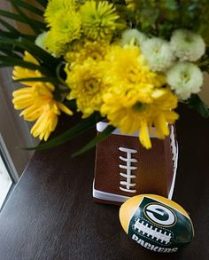 @Jackie Wiersma More ideas. . .the base of this flower pot is just football scrapbook paper! INGENIOUS!! :)