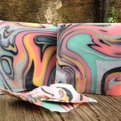 April Soap Challenge - Spinning swirl. Summer Swing. Smells of sweet orange and eucalyptus. Fun Colours Pink, Teal, Yellow, Black and Grey. Made with Olive Oil, Coconut oil, Sweet Almond and Mango butter. I have fallen in love with the spinning swirl! Story of Summer Swing : This is my second attempt at the spinning swirl, first one I chose a different FO and it accelerated so it was for of a glob swirl. Thanks to #greatcakesoapworks for putting on the challenge.