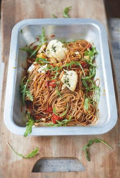 Enjoy pasta and be healthy with this spelt spaghetti, vine tomatoes and baked ricotta dish in Jamie Oliver's Everyday Super Food cookbook.