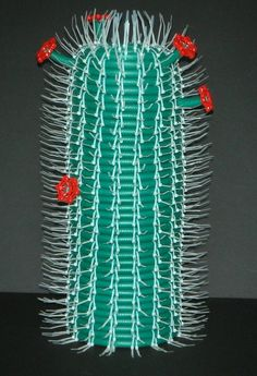Garden Hose, Zip Ties, and Faucet Handles upcycled into a cactus sculpture by artist Brian Jewett