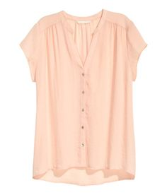 Check this out! Wide-cut blouse in airy woven fabric with buttons at front, V-neck, gathered shoulders, and cap sleeves. Longer at back. - Visit hm.com…