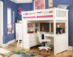Beautiful loft bed in pink and white with a desk underneath