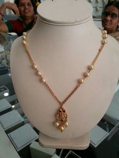 Simple pearl and gold necklace with simple pendant