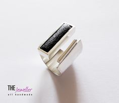 Sterling silver ring with genuine black leather. Designed and handcrafted in Romania by G. David for www.thejeweller.ro