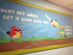 Angry Birds bulletin board for spring. The mighty eagle is reading a book called Los Cochinos(The Pigs).