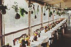 hanging plants over reception tables // Photo by Jonathan Ong | VIA #WEDDINGPINS.NET