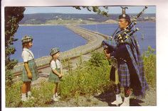 Bagpiper at Canso Causeway opening in 1955. Before the causeway was built with rock blasted from Cape Porcupine, the only way to travel between mainland Nova Scotia and Cape Breton was by boat, ferry, car ferries, etc. The Canso Strait freezes in winter on one side and the other side stays ice free and open. There are locks and a swing bridge on the causeway to allow passage for the many vessels travelling through the Strait.