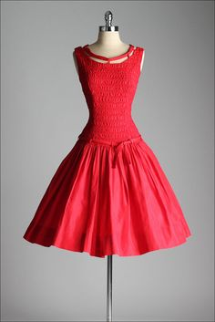 ➳ vintage 1950s dress    * red taffeta  * smocked bodice  * dropped waist  * unique tie collar  * tie at waist  * metal side zipper  * by Vicky