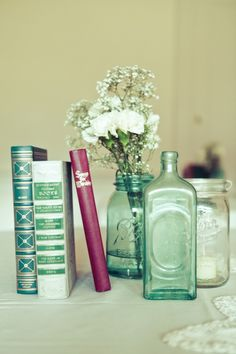 books and jars of flowers