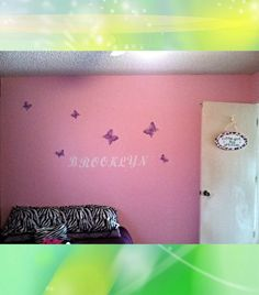 I painted her name and used super glue to attach butterflies I found at the dollar store.