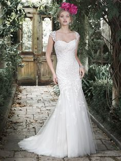 Maggie Sottero - AZURA, This lace fit and flare wedding dress channels timeless elegance with its classic sweetheart neckline, cascading floral lace appliqués and flared tulle skirt. Lace cap-sleeves offered separately. Finished with corset closure.
