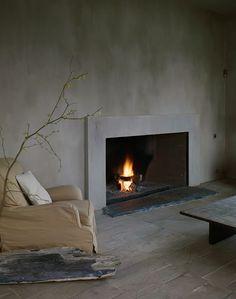 Axel Vervoordt, stippled wall, fireplace