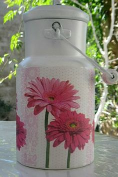 Decoupage on a milk can.. must try it on mine!