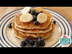 How to make gorgeous fluffy greek yoghurt pancakes. These pancakes are healthier and made with egg whites, but that does not stop the amazing flavour of the finished article top with bananas and blueberries with a cheeky drizzle of honey!