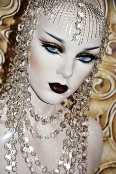 white face portrait with rhinestones and red lipstick