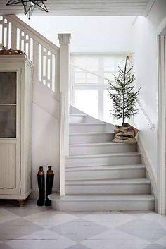 scandinavian christmas decor staircase with christmas tree