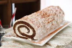 Gingerbread roll cake - A moist gingerbread cake filled with a spiced creamy filling.