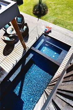 Peter McDonald's contemporary beach house Pool and spa with black tile interior.