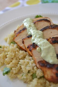 Blackened Chicken and Cilantro Lime Quinoa (Don't worry, that creamy sauce is just avocado and nonfat plain Greek yogurt - YUM!) via Sarcastic Cooking