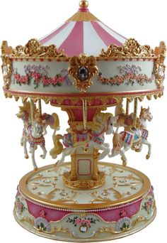 The largest in the Carousels of Distinction collection. This fine musical carousel has six individual horses that each go up & down on their brass rods as ...