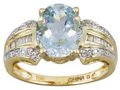 Altai Aquamarine 2.25ct Oval With .12ctw Round And Baguette Diamond 10k Yellow Gold Ring