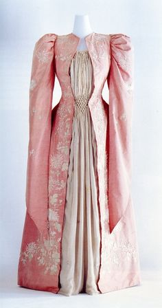 Kyoto Costume Institute Tea Gown c. 1895・Japan Material: Pink seigou dress; gray jabot and plastron of yoryu (seigou and yoryu are Japanese textiles); Piedmontèse pleat at back; medieval-like hanging sleeves; lining of habutae silk machine-quilted with...