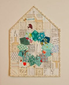Karyn Vilano's paper pieced quilt as a series of wall hangings....