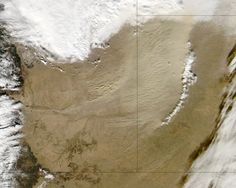A cold front pushed eastward across the continental United States in early 2013, passing through Colorado on January 11. Ahead of the cold front, a dust storm arose along the Colorado-Kansas border. The Moderate Resolution Imaging Spectroradiometer (MODIS) on NASA's Aqua satellite captured this natural-color image on January 11, 2013.