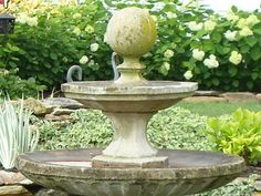 it's very simple to put together...  two different sizes of birdbaths and a finial, stacked on top of each other.  it gives the effect of a fountain without the work of one. This is surrounded by lavender ... another classic that doesn't wear out its welcome here!