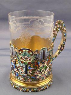 A Russian teaglass with silver gilt holder having fine shaded cloisonne enamel decoration. Konstantin Sevortsov, Moscow, circa 1908. Ht. holder 10.5cm., overall. 12cm.