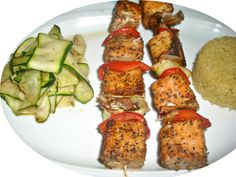 Salmon skewers with honey sriracha salmon, mushrooms, onions and red pepper, quinoa, and zucchini ribbons.