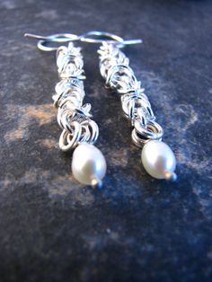 Items similar to Silver Chain and Fresh Water Pearl Earrings on Etsy Water Pearls, Fresh Water, Pearl Earrings, Chain, Silver, Etsy, Jewelry, Water Beads, Pearl Studs