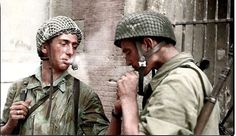 two German Fallschirmjäger (paratroopers) from the 3rd Parachute Division (Germany) taking a smoke break in the Arnhem area during Operation Market Garden. September, 1944. This Fallschirmjäger division was active from 1943-1945.