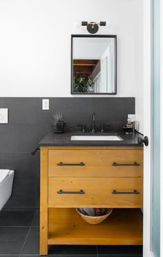 """No master bath? Not a problem for these renovators— Amy and Kevin updated the two baths in their 1950s home into """"his"""" and """"hers"""" in this Los Angeles renovation. Bathroom Renovations, Home Remodeling, Bathrooms, Cedar And Moss, 1950s House, Wall Mounted Toilet, Engineered Hardwood Flooring, Wood Ceilings, Ship Lap Walls"""