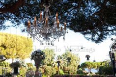 Cristal chandelier hung on tree over your dinner tables. Wedding by Monte-Carlo Weddings.