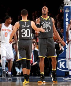 Stephen Curry and David West of the Golden State Warriors high five during the game against the New York Knicks on February 26 2018 at Madison Square...