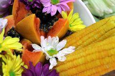 Milho, mamão e flores