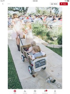 We restored an old red wagon, lined it with a satin pillow we custom made for it and decorated it with the chalkboard and lace. The best part were the tin cans we wrapped in twine and strung to the back of the wagon. Wagon For Wedding, Wedding Prep, Wedding With Kids, Sister Wedding, Paris Wedding, Spring Wedding, Dream Wedding, Rustic Wedding Details, Wedding Inspiration