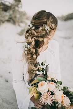 Relaxed braid with flowers for rustic wedding | India Earl Photography | See more: http://theweddingplaybook.com/rustic-peach-gold-green-wedding-inspiration/