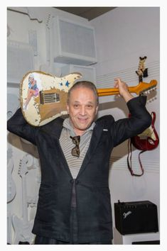 Jimmy Vaughan poses in front of a photo of his brother Stevie Ray at GRAMMY Museum Mississippi on June 2016 in Cleveland, Mississippi. Get premium, high resolution news photos at Getty Images Jimmie Vaughan, Anaheim Convention Center, Grammy Museum, Blues Artists, Stevie Ray Vaughan, David Gilmour, Keith Richards, Freddy Krueger, Def Leppard