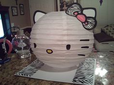 Zebra Bow Hello Kitty Inspired Lantern By shelbynbosch on Etsy Decoracion Hello Kitty, Hello Kitty Birthday, Hello Kitty Collection, Paper Lanterns, White Lanterns, Cat Party, Here Kitty Kitty, Holidays And Events, Sanrio