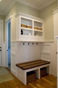 mud room built into a pretty small area. Shelves, hooks, drawers, seat, basket/shoe area, plus add'l storage above shelf unit.