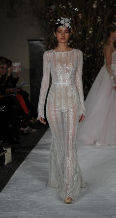 Long sleeved sheer gown with high neckline | Mira Zwillinger Spring 2017 | https://www.theknot.com/content/mira-zwillinger-wedding-dresses-bridal-fashion-week-spring-2017