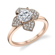 Floral Halo Rose Gold Diamond Engagement Ring - This stunning diamond engagement ring features a 1 carat round center with a total of 0.29 carats in a feminine floral halo.  #wedding   #fashion   #engagement   #jewelry   #ring