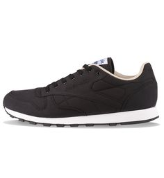Reebok CL Leather Clean 60/40 Black / Oatmeal / White - Reebok The Reebok CL Leather Clean 60/40 Black has cotton and nylon uppers, a woven patch on tongue, a rubber sole and a embroidered logos. Free UK delivery.