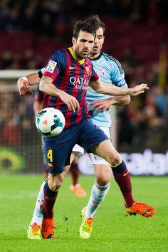 Cesc Fabregas of FC Barcelona plays the ball close to Borja Oubina (behind) of RC Celta de Vigo during the La Liga match between FC Barcelona and RC Celta de Vigo at Camp Nou on March 26, 2014 in Barcelona, Catalonia.